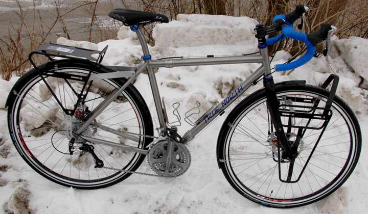 A Pair of True North Cycles Titanium touring bikes with S and S Couplings